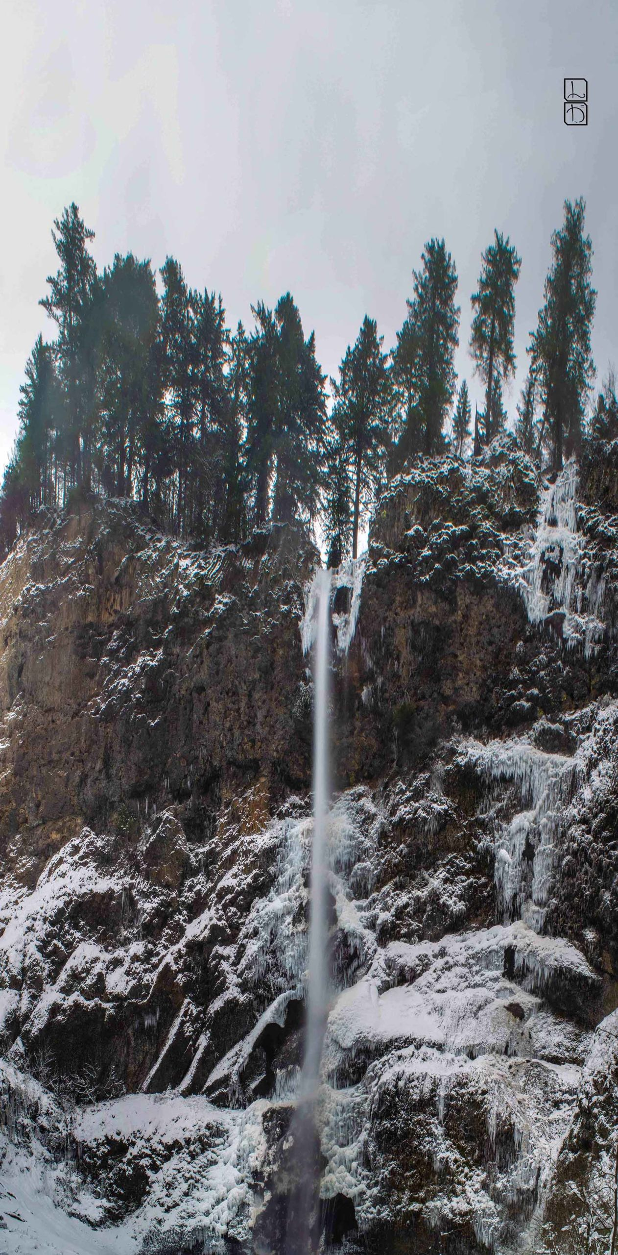 Wide angle photomerge of Multnomah Falls in the snowy, icy winter
