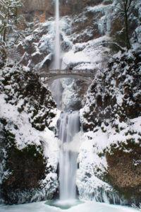 Snow covered cliff edges at Multnomah falls.