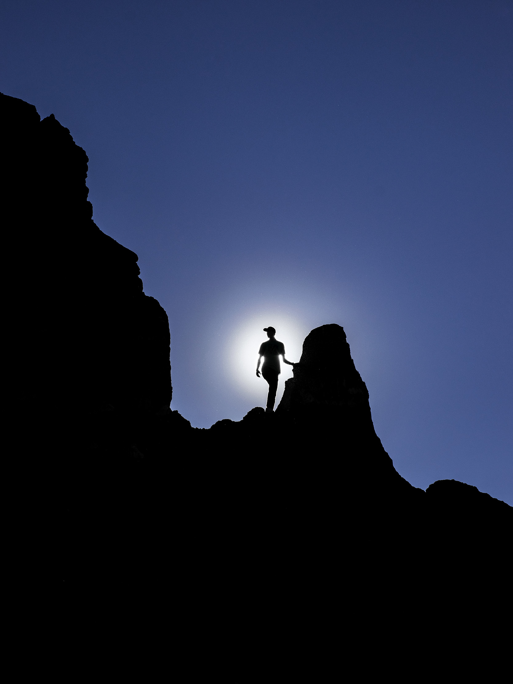 Silhouette of Timm Derrickson standing on a cliff edge at Palo Duro canyon