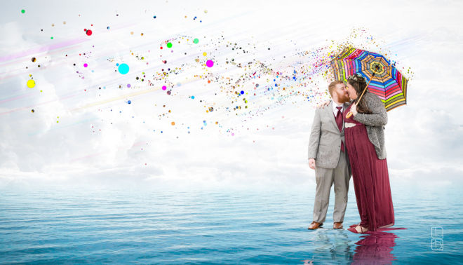 digital illustration of two newly weds standing on an imaginary ocean, holding a raindbow colored umbrella as speckles of color drift into the distance.