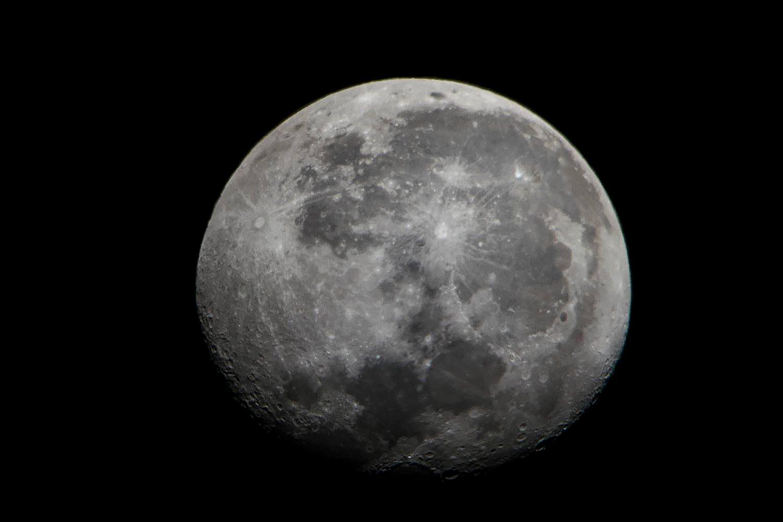 close up of full moon taken through dobsonian telescope