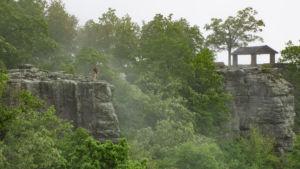 Travis Elston standing on White Rock Mountain cliff in Arkansas