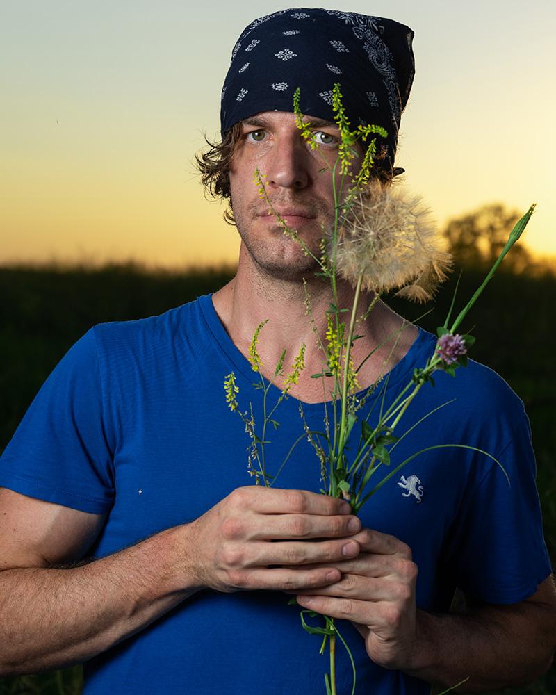 Leif Derrickson with wild flowers