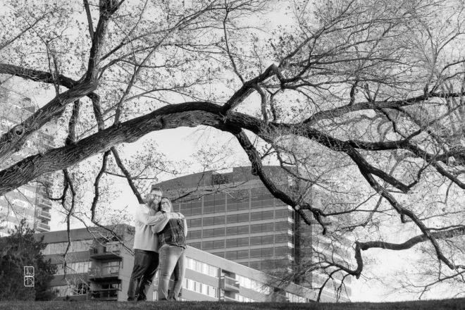 Dave and Bethany Strieff standing on a hill in Kansas City black and white