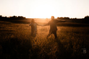 Dave and Bethany Strieff dancing in a field at sunset